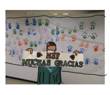 Un paciente levanta una pancarta luego de pintar sus manos en señal de triunfo, al ser dado de alta en el Hospital Pérez de León II de Petare, Venezuela, en el que apoyamos la atención de pacientes con COVID-19.