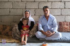 Hadji Charmeed y su familia en el edificio sin terminar donde se refugiaron luego de tener que huir de su casa. Lucia Brinzanik/MSF